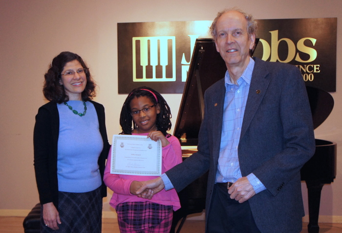 Shelby Edouard with her teacher, Christianne Lane and Charles Skinner, Chair of the Board of Trustees.